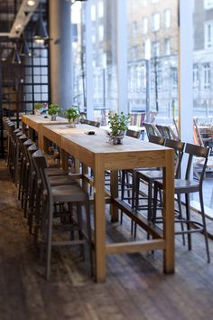 Cafe Bar Table And Chairs. Modern Round Home Bar Wooden Furniture House . Primo Cafe Bar By DIA Dittel Architekten Archiscene . Home and Family Café Bar, Table Bar, Bar Height Table, Tall Table, Table And Chairs, Pub Bar, Room Chairs, Bar Table Design, Long Narrow Dining Table