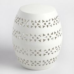 Decorated with a punched floral design, our stool is an eclectic seating solution for the patio or porch that also doubles as an accent table. www.worldmarket.com #WorldMarket Outdoor