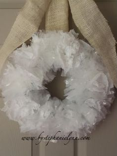Recycle Plastic Bag Wreath.    Hang it on the garden gate! or fence, or garage or a tree or...{fill in the blank}  Fun!
