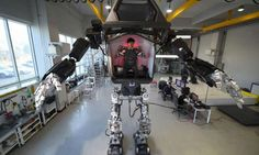 "Engineers test a four-metre-tall humanoid manned robot dubbed Method-2 in a lab of the Hankook Mirae Technology in Gunpo, south of Seoul, on December 27, 2016. The giant human-like robot bears a striking resemblance to the military robots starring in the movie ""Avatar"" and is claimed as a world first by its creators from a South Korean robotic company"