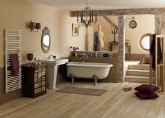 Rustic bathroom.  From Campagne Decoration (in French.) The space in the foreground seems ridiculously large, I suspect this is a stage set.  :-)