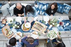 Aerial view of dinner party and guests // tie-dyed table runner and pillows