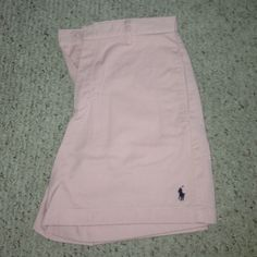 "High Waisted Ralph Lauren Polo Sport Shorts Perfect pre-owned condition, never got to wear them anywhere, baby pink Golf shorts with navy blue embroidered Polo logo 15"" top to bottom, 5"" inseem. I will bundle if interested in multiple pair! No trades (cheaper on eBay and ♏️) Ralph Lauren Shorts"