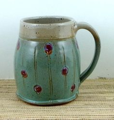 i want a collection of these handmade ceramic mugs by Suzanne Rehbock.