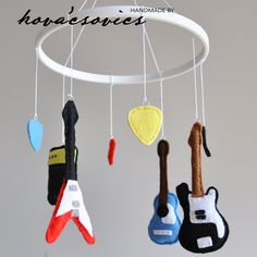 Hey, I found this really awesome Etsy listing at https://www.etsy.com/listing/168334024/crib-mobile-nursery-decoration-guitars