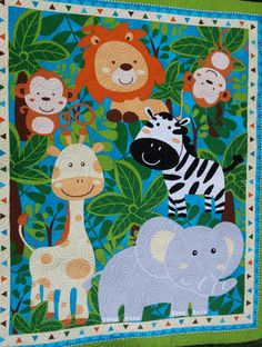 Crib quilt featuring Jungle animals  gender by morethanjustquilts