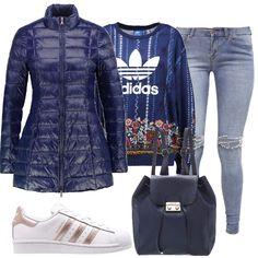 Un outfit adatto a tutte le ragazze giovani che amano lo sport ma anche essere alla moda. Il piumino blu si porta con disinvoltura abbinato alla felpa sporty chic e al jeans slavato. Per terminare il look un paio di sneakers e uno zainetto in similpelle di Guess.