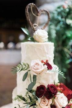 Romantic rustic floral topped wedding cake: http://www.stylemepretty.com/little-black-book-blog/2017/02/13/romantic-warm-winter-california-wedding/ Photography: Hello Blue - http://hellobluephoto.com/