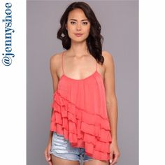 """{free people} asymmetrical ruffled tank Quirky and girly asymmetrical ruffled tank from free people in tomato.   Scoop neck, sleeveless, ruffled tier with an asymmetrical flounce.  Approx 16.5"""" shortest length, 20"""" longest length.   100% rayon.  Size small. Brand new with tags. Retails $78 Free People Tops Camisoles"""