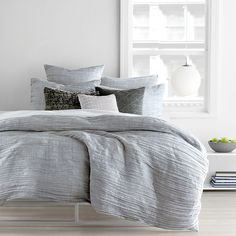Engage your space with the pared-down elegance of Dkny's City Pleat duvet cover in light grey. Horizontal pleats dance across the front, creating a sense of soothing movement and warm allure in your b