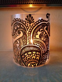 Used candle holder decorated with mehendi..a lovely way to brighten up a room.