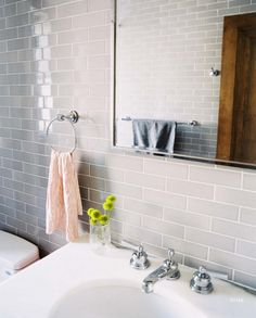 Grey tiled bathroom - add citrus colours with accessories - large vintage mirror