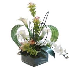 Enjoy the beauty of flowers throughout the seasons with this gorgeous design, perfect for bringing lush, organic appeal to your home d�cor. Product: Faux floral arrangementConstruction Material: Silk, plastic and glassColor: Pink, green and whiteFeatures: Indoor use onlyDimensions: 23 H x 18 W x 24 D Tropical Flower Arrangements, Modern Floral Arrangements, Floral Centerpieces, Tropical Flowers, Deco Floral, Arte Floral, Floral Design, Faux Flowers, Silk Flowers