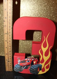 This listing is for one 9 Blaze and the Monster Machine inspired number. All sides are painted and can be made with any number just convo me. Will add the perfect touch to you childs birthday party. Please allow 3-5 days processing. Also include your event month and date. See my