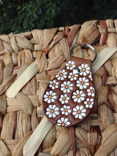 Embossed Daisies on a Leather Keyring by GratifyDesign on Etsy, $7.00