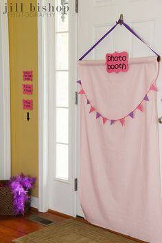 set up a photobooth display on the back of a door with a removeable hook...no tutorial but the idea is pretty basic