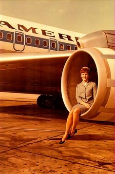 SFO based Pan Am Stewardess Mary Hoksbergen in engine of B707 at SYD 1966