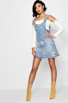 6924e216b09 Click here to find out about the Gia Embroidered Denim Pinafore Dress from  Boohoo