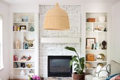 Before this blogger tackled her fireplace, it was a brown eyesore of a statement. But white paint and IKEA's iconic BILLY bookcases planking both sides turned it into a stylish built-in that makes the fire the star of the room. See more at Place of My Taste »