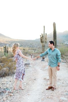 Love this romantic lavender floral dress and his desert green shirt.  Fits nicely in the desert scenery.  Fun desert engagement shoot with Arizona Wedding photographer Pinkerton Photography.