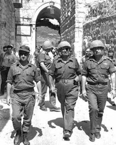 Moshe Dayan (M), Chief of Staff Rabin (R) walking through the Old City's Lion's Gate (Archives: GPO)