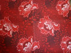 3 Cats Shweshwe: Hibiscus in Red. Worldwide shipping available from http://www.meerkatshweshwe.com/