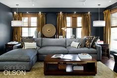 This room must accommodate a lot of people, so I incorporated a new sectional.  This big sectional- and I mean big- offers 11 feet of sitting space!   A long, L-shaped sectional covered in durable, easy-to-clean blue-gray microfiber is perfect for kids, family and even the basketball team. #candiceolson