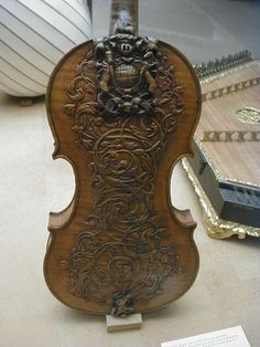 hobochord:  A intricately carved 17th Century British Royal Family violin. On display in the Victoria and Albert Museum in London.