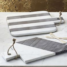 contemporary  brass and marble kitchen mood board | Marble cutting boards with lots of character.