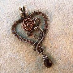 sterling silver and copper wire to build this heart-shaped pendant. It is woven together with fine gauge sterling silver, using a block pattern for a mechanical look.