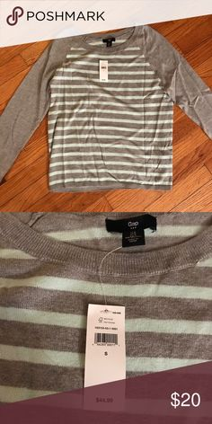 NWT gap sweater Brand new with tags gap sweater. Gray with aqua striped on front and back. Perfect condition. GAP Sweaters