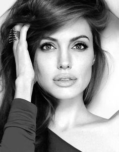 Angelina Jolie- she's a bad white chick.  i say that because she's not your typical white women who can't kick butt and still look beautiful and stunning. that's why i like her.