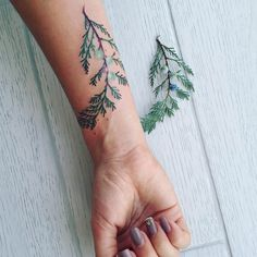 Pis Saro depicts plants as realistically as possible on skin in the form of colorful tattoos. The Crimea-based tattoo artist uses her clients' skins as canvases for some gorgeously rendered leaves, flower petals, branches, and fruit. Each tattoo is based on a real-life item that Saro refers to and, when compared side-by-side, is nearly identical to the artists' depiction. Below are a number of Saro's tattoos. Check 'em out and find new work on her Instagram.