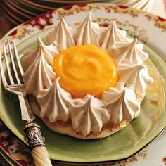 Meringue Flowers with Lemon Curd  Serve these tarts individually on plates or put them on a cake stand for a cheery display so guests can serve themselves when the mood strikes.