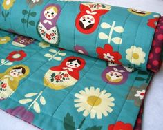 matryoshkas dolls baby quilt in turquoise teal blue / Russian nesting girls bedding (limited edition). $120.00, via Etsy.