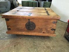 old looking coffee table that opens at each end for storage like a chest