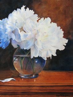 Clear vessels and white peonies