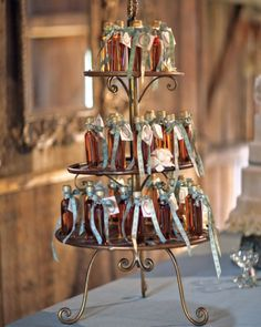 Sugary Sweet. The couple bottled fresh maple syrup from the groom's family's sugarhouse and finished them off with elegant ribbon and a tag.