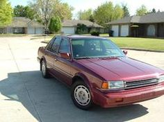1987 Nissan Stanza. Bought with the insurance money from the crash of the Corsica. Nice interior. My first sun roof.