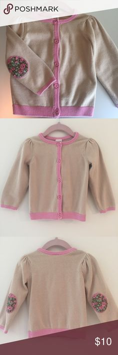 H&M Cotton Baby Cardigan H&M Baby Cardigan in Cream with Pink trim. Pink flower buttons and floral elbow patches. 100% Cotton. Gently used and in Excellent Condition. H&M Shirts & Tops Sweaters