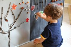 A beautiful invitation to create a fall tree with magnetic sticks, leaves, acorns, and pom poms. Great for fine motor, imaginative play, creativity, and more!