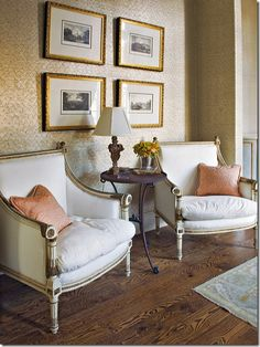 These identically framed prints hung symmetrically are perfect with this traditional decor.