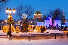 Canada, Quebec province, Quebec, Quebec Winter Carnival, Ice Palace of Bonhomme Carnaval, in the background the illuminated Chateau Frontenac