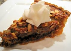 Kentucky Derby Pie ---- sounds yummy.  Uses almonds and chocolate (may sub with pecans if desired)