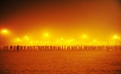 Sadhus or holy men walk in a procession towards the Sangham or the confluence of the the Yamuna and Ganges rivers to bathe before sunrise during the Kumbh Mela in Allahabad on January 14, 2013.  AFP PHOTO/SANJAY KANOJIA