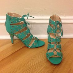 Teal lace up high heels Teal lace up high heels. Zipper in back. Brand new, never worn, only tried on. Cut out design and beautiful real color. Size 7. Shoes Heels