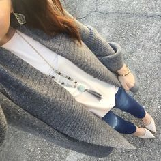 Houston fashion blogger Lady in Violet styles a winter casual outfit with a gray long cardigan and distressed jeans under 100.