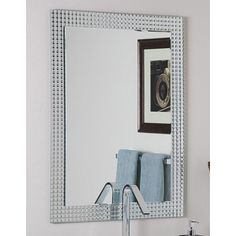 <li>Add an elegant touch to any interior space with the frameless 'disco' wall mirror <li>Mirror crafted of 2 levels of thick, strong 3/16-inch glass and metal <li>Wall mirror's metal encased in glass border created by a precise manufacturing process