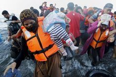 Syrian refugee mother carries her child off a dinghy after arriving at a beach on the Greek island of Lesbos after crossing a part of the Aegean Sea from Turkey September Refugee Crisis, Syrian Refugees, Riveting, Woman Beach, Press Photo, Human Rights, In This Moment, Dinghy, Pictures