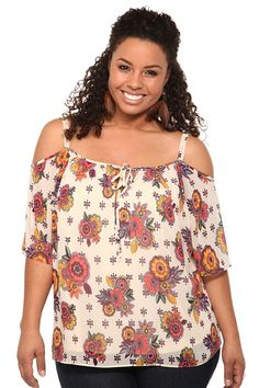 I love this blouse. I'm even wearing it right now. It's a cute, flirty, fun, feminine, flouncy, floral top that's off the shoulder and has a keyhole cutout.